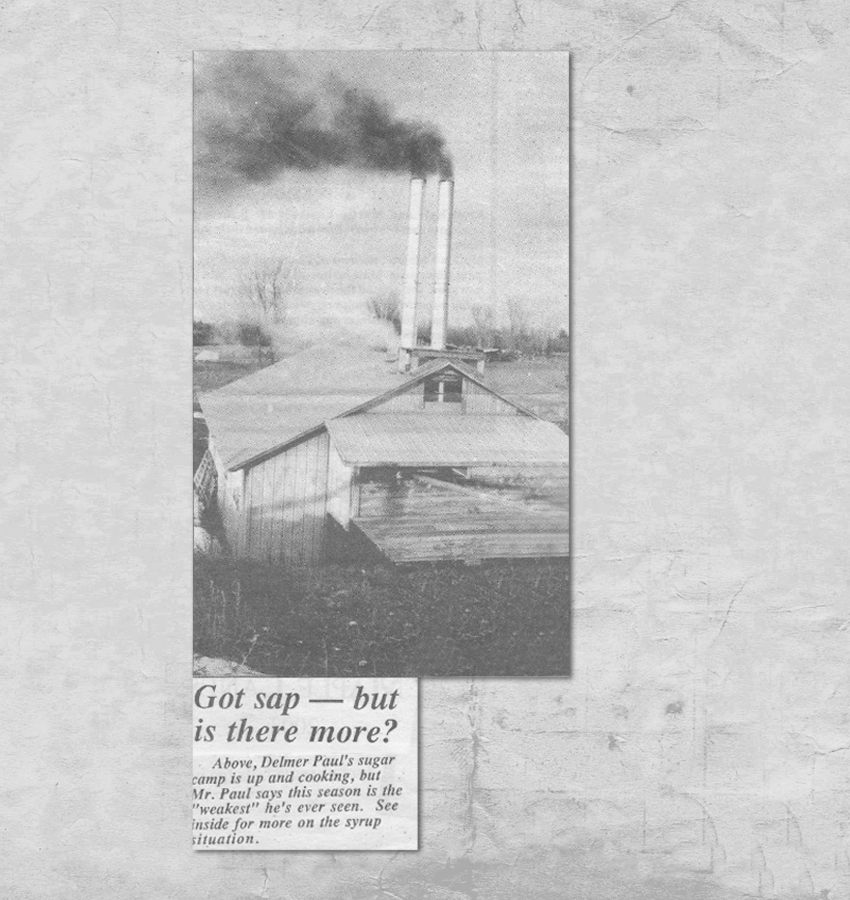 """Newspaper Print. Caption reads: """"Got sap --- but is there more? Above, Delmer Paul's sugar camp is up and cooking, but Mr. Paul says this season is the 'weakest' he's ever seen. See inside for more on the syrup situation."""""""