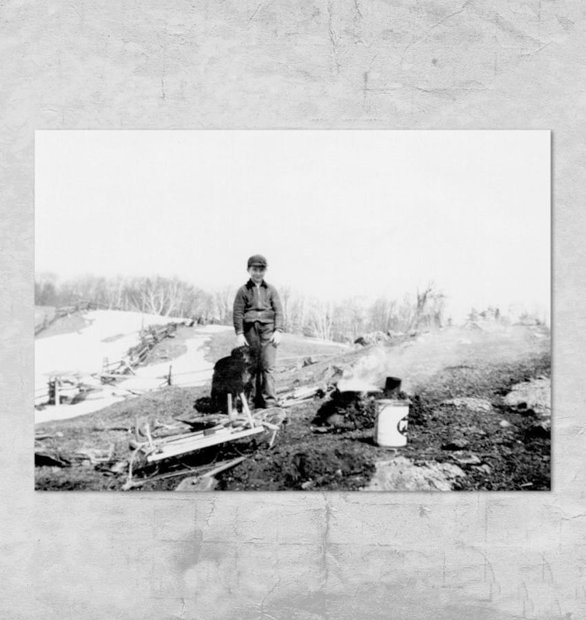 Delmer Paul boiling sap on an open fire - 1944